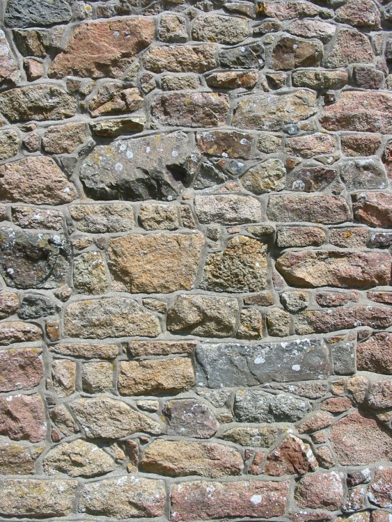 Granite_wall_of_chapel_La_Hougue_Bie,_Je